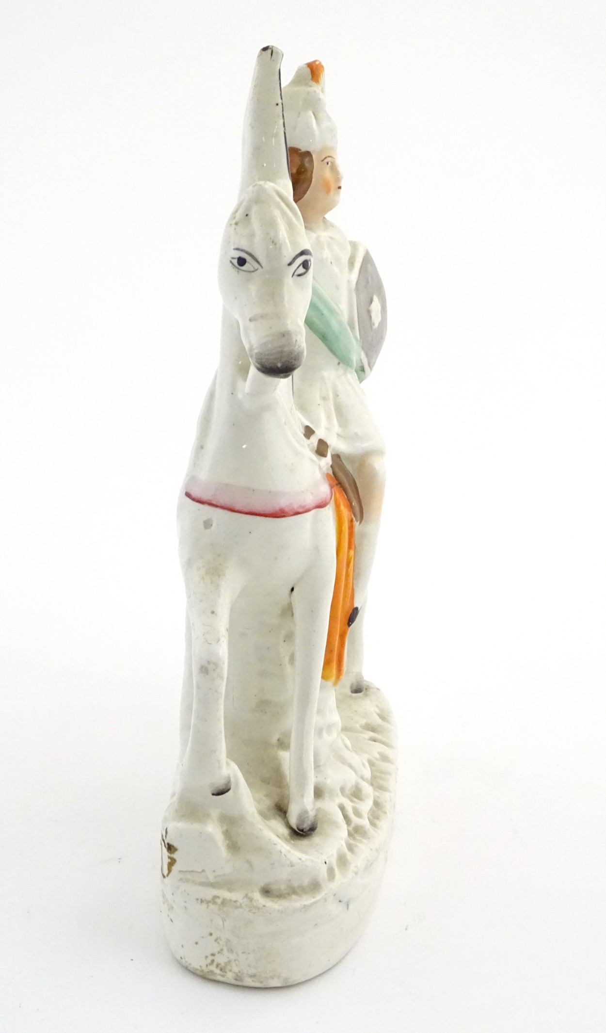 """Lot 55 - A Staffordshire pottery flat back figure of a knight on horseback. Approx. 11"""" high."""