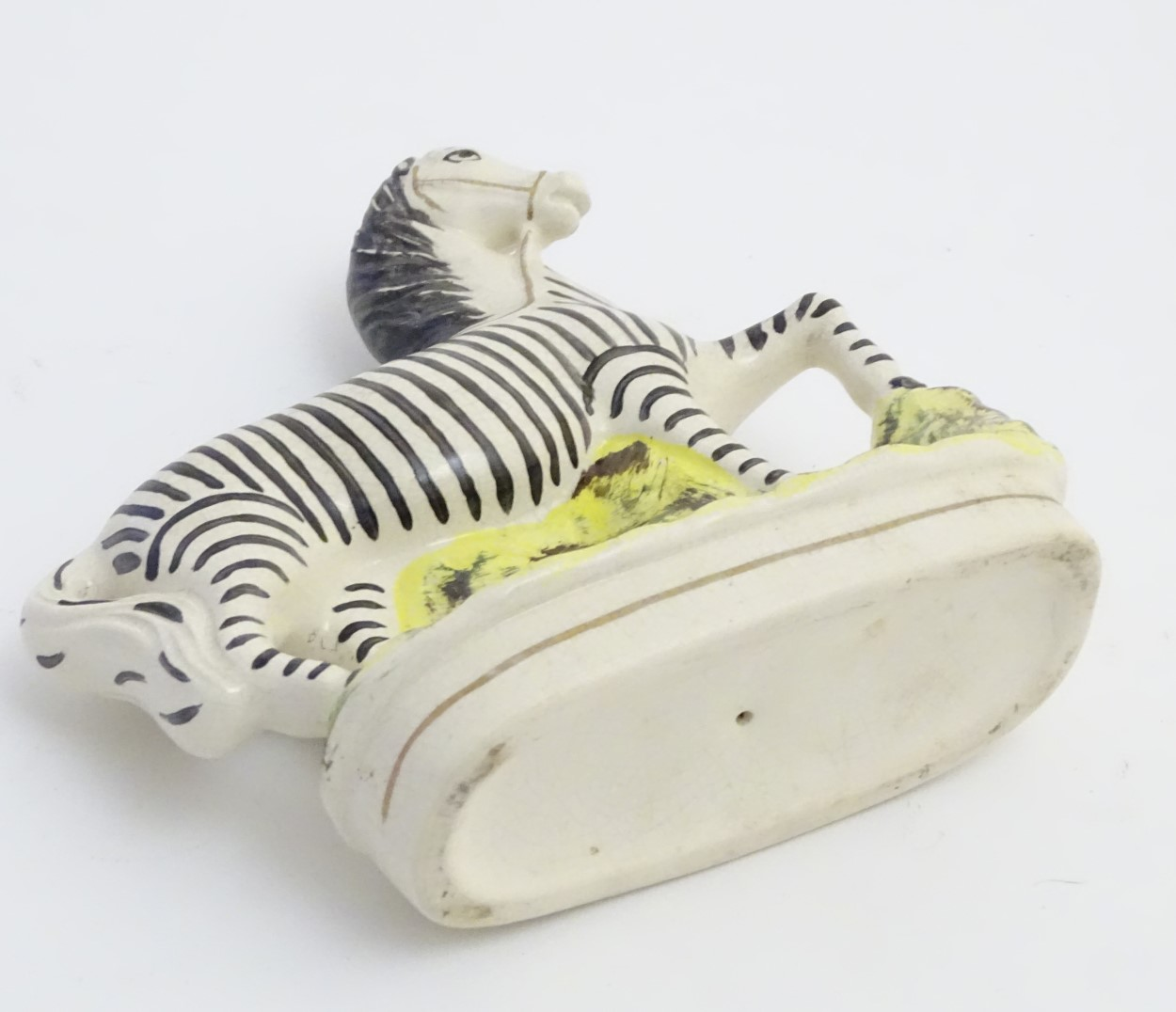 Lot 51 - A flat back Staffordshire circus pony painted as a zebra with gilt highlights. Approx.