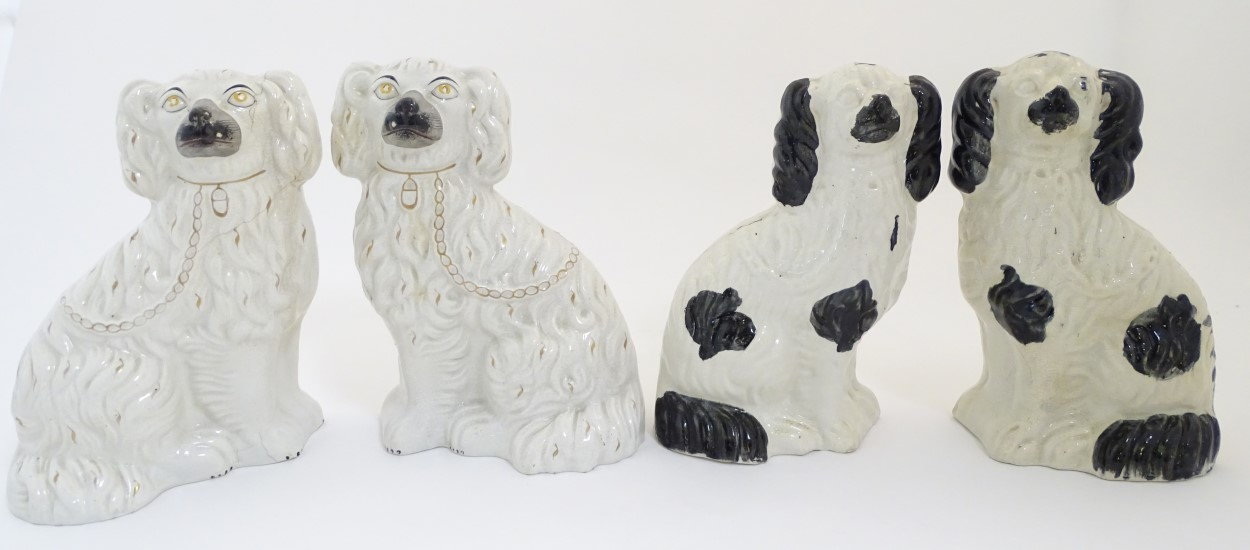 Lot 54 - Two pairs of Staffordshire Victorian seated spaniels.