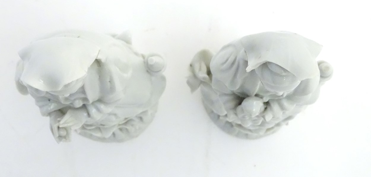 A matched pair of dehua porcelain/blanc de Chine figures, - Image 7 of 7