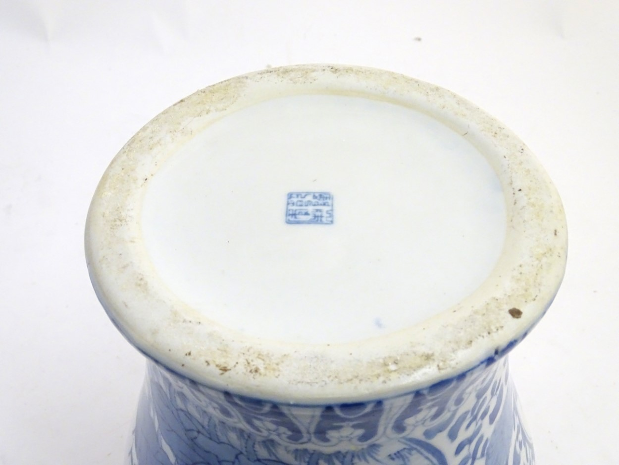 Lot 30A - A large blue and white ginger jar decorated with stylised flowers and banded Greek key,