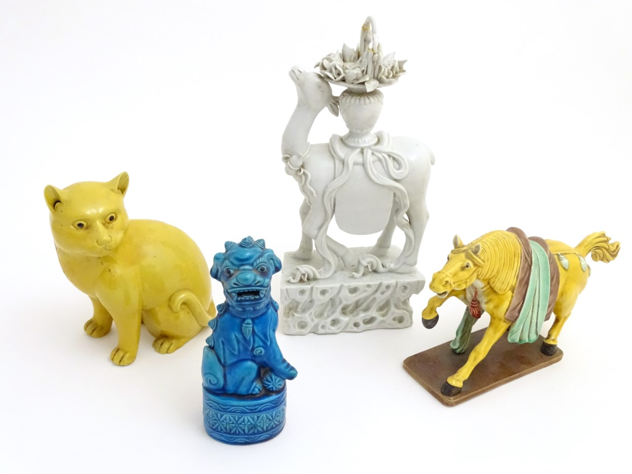 Lot 19 - A quantity of Chinese ceramic animals to include a seated cat, a horse,