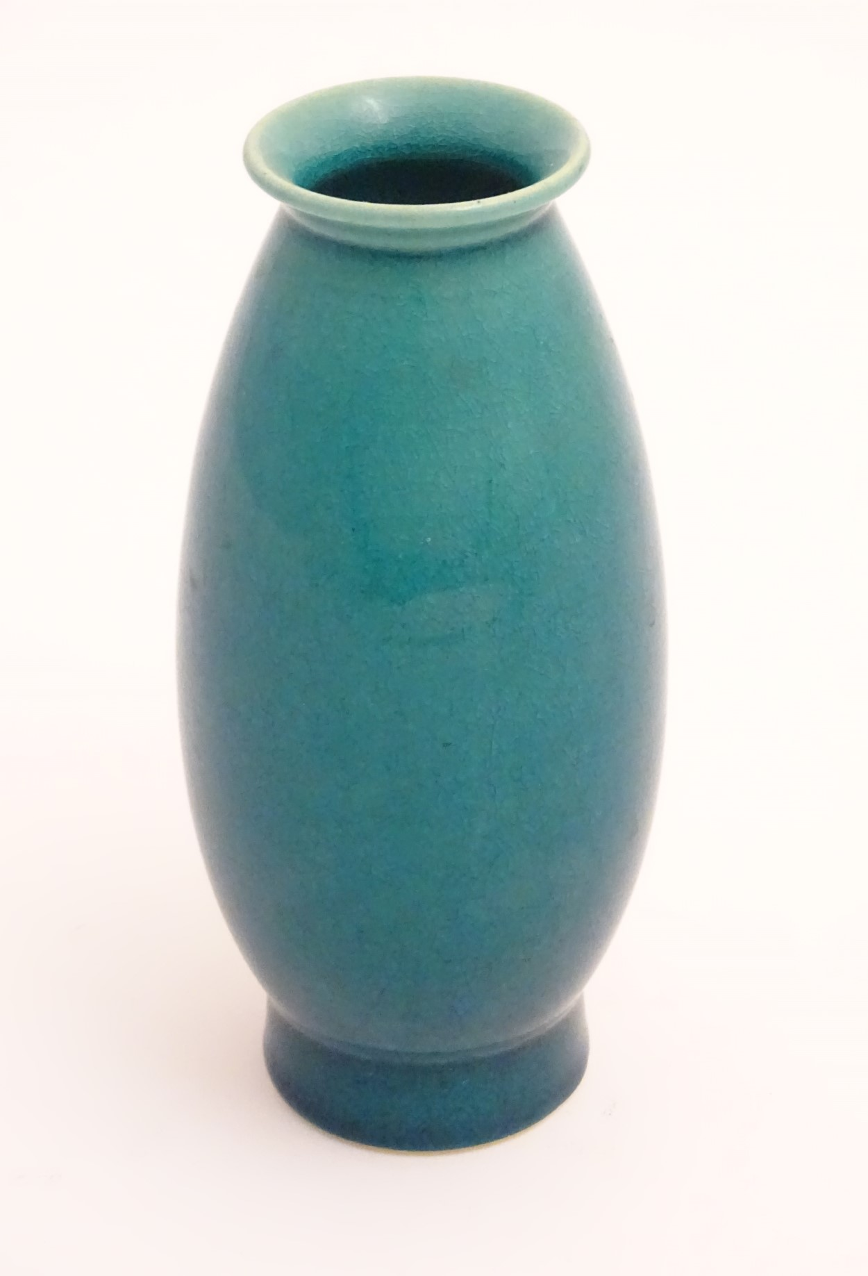 Lot 17 - An oriental vase of ovoid form with a flared rim and base with craquelure decoration. Approx.
