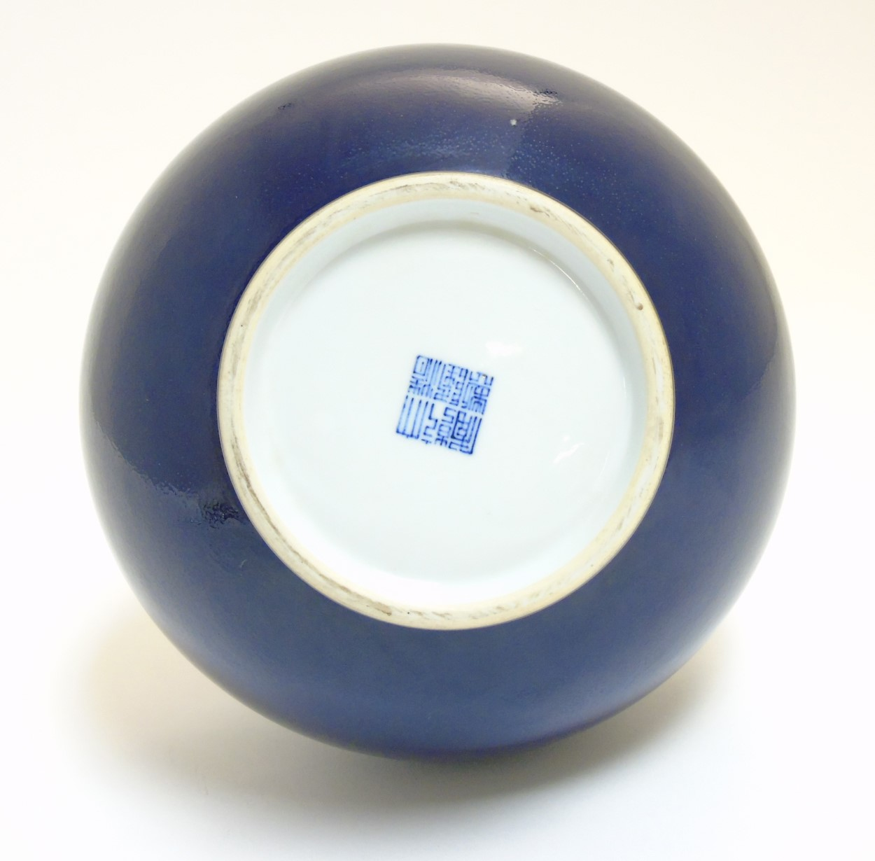 Lot 44 - A Chinese blue monochrome Shangping vase with globular body and flared rim,