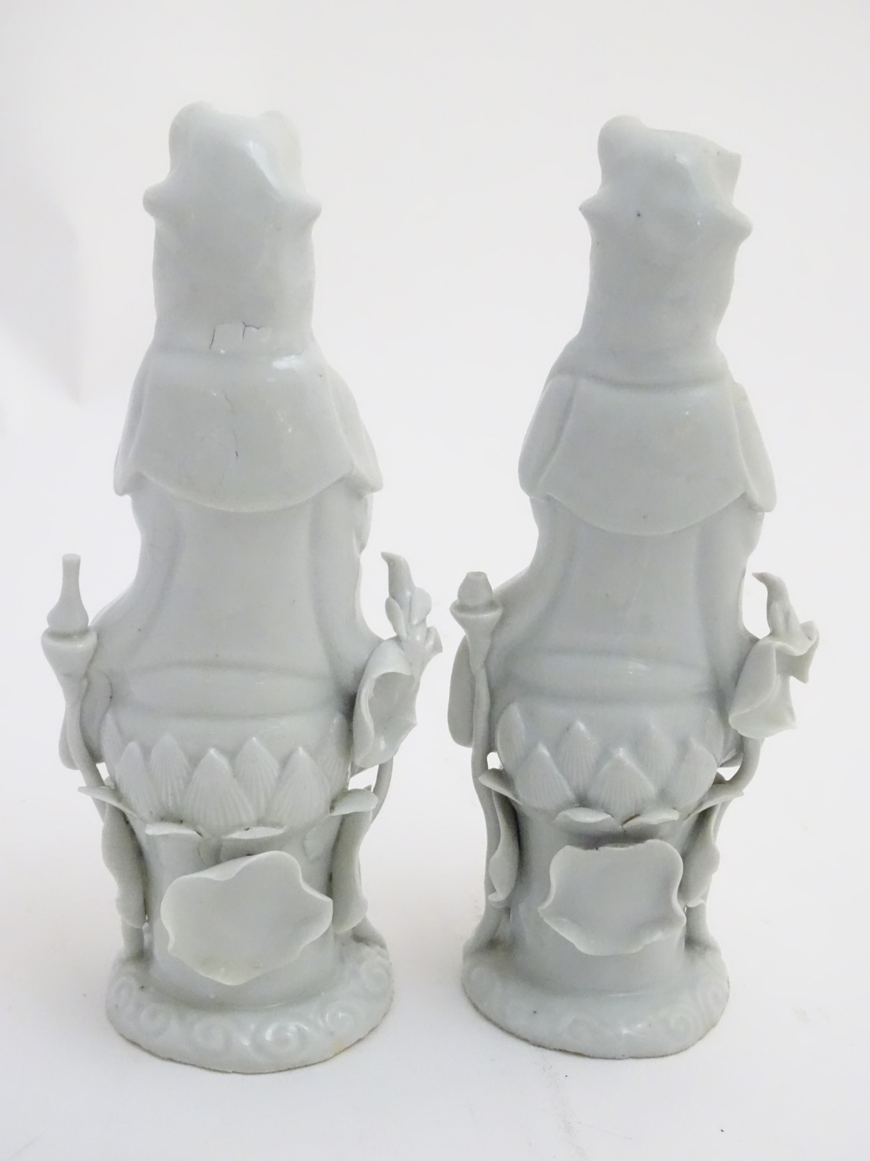 A matched pair of dehua porcelain/blanc de Chine figures, - Image 5 of 7