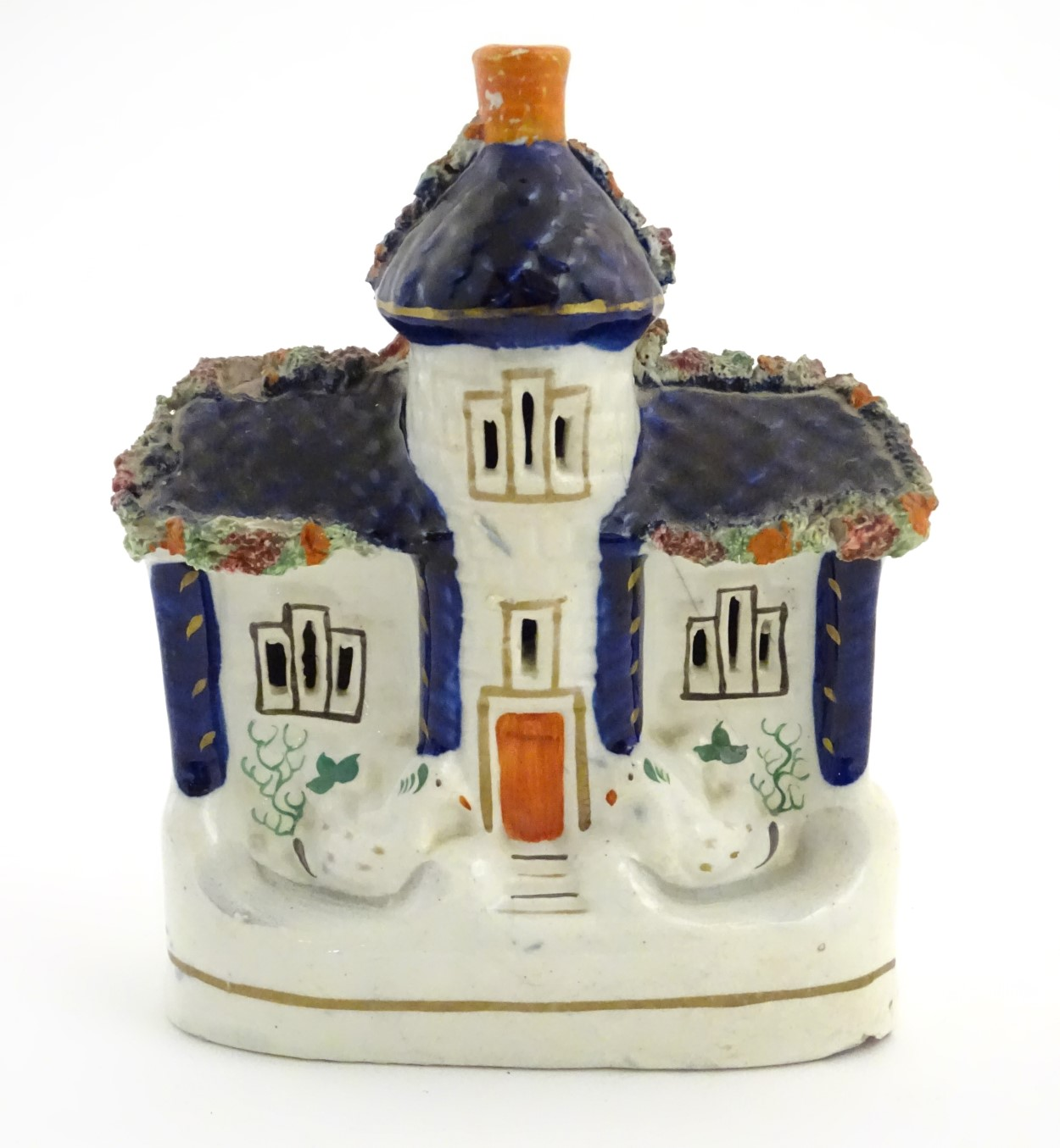"""Lot 48 - A Staffordshire pottery model of a flat back house. Approx. 6 1/2"""" tall x 4 1/2"""" wide."""