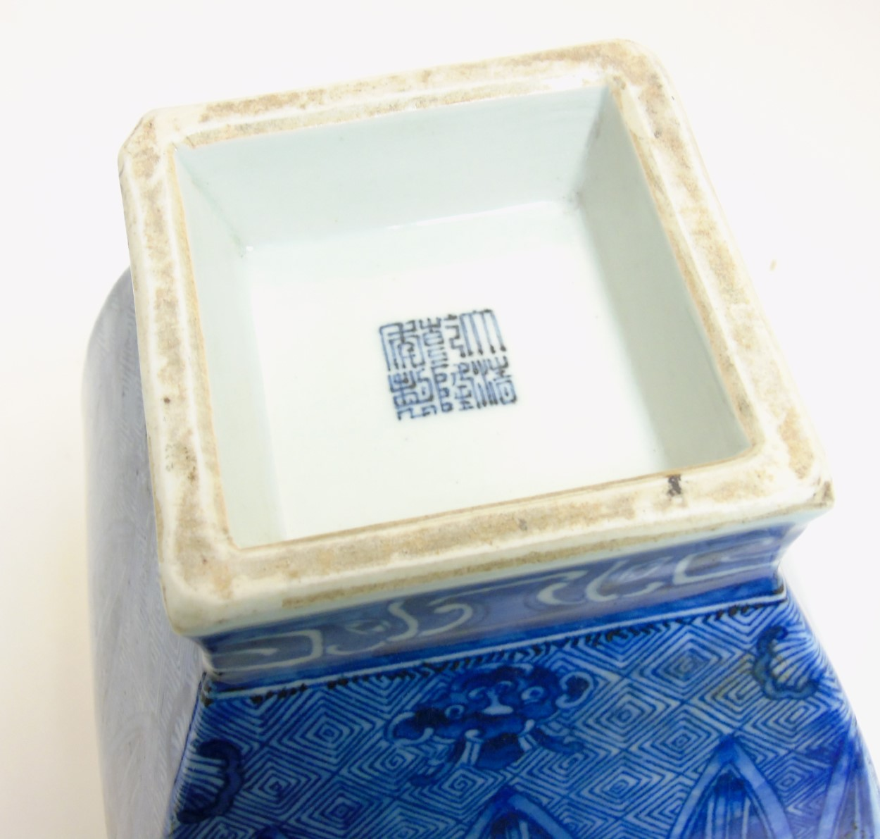 Lot 30 - A Chinese blue and white square section vase, with archaic style decoration ,