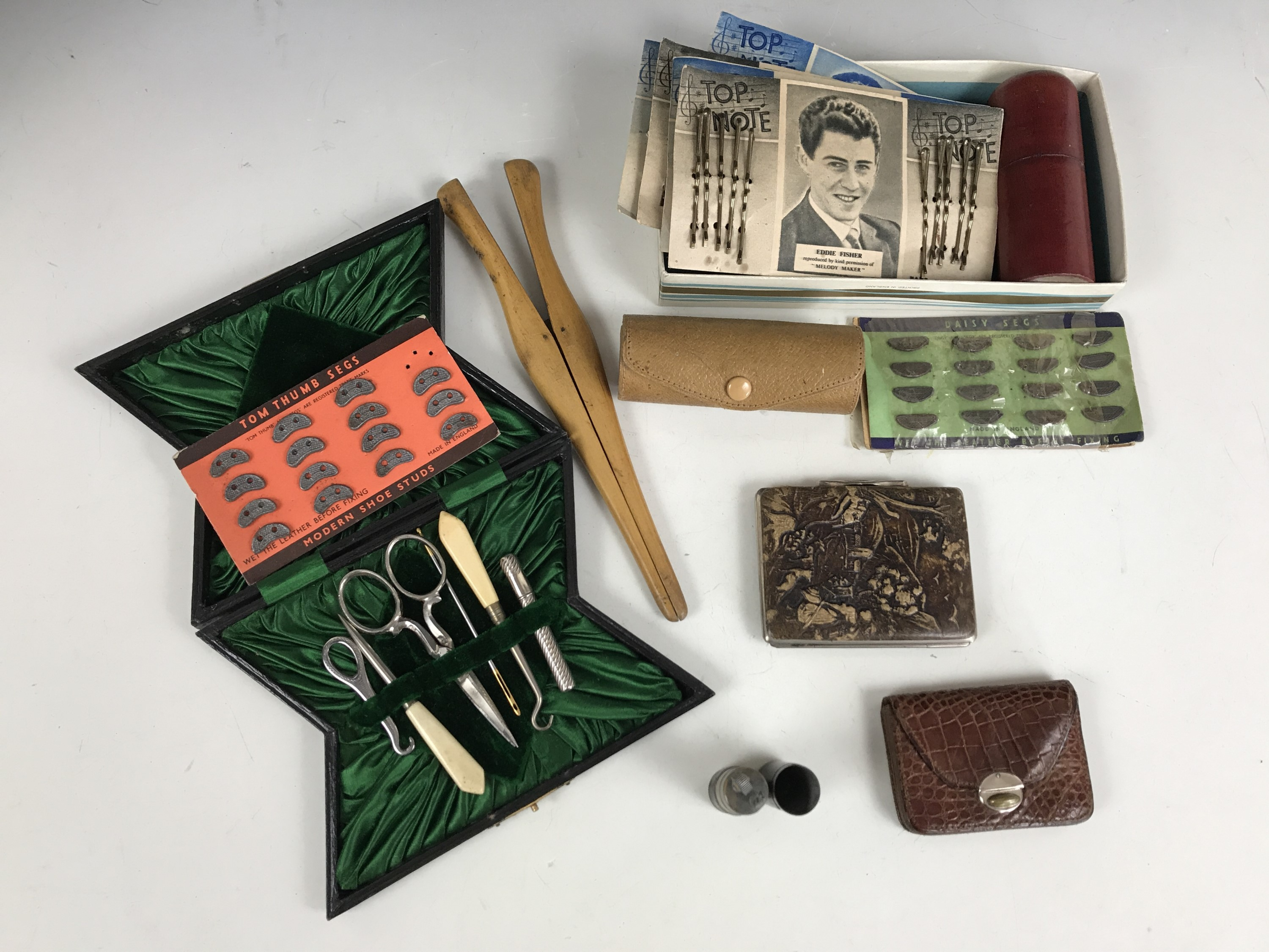 Lot 22 - Collectors' items including a late 19th Century cased sewing set, an early 20th Century travel