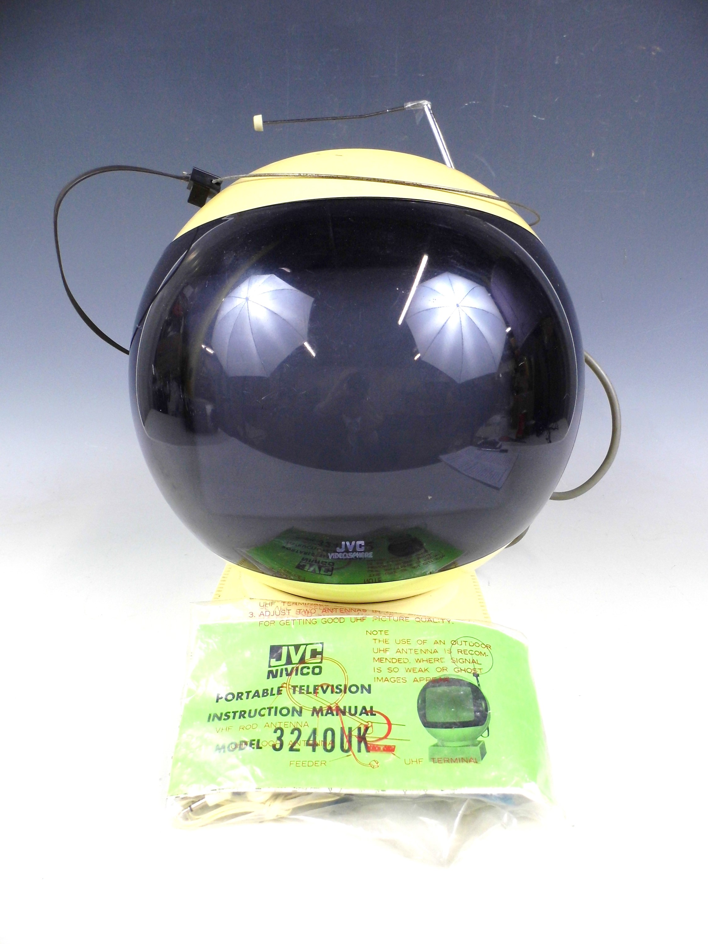 Lot 3 - A novelty Space helmet shaped TV with stand