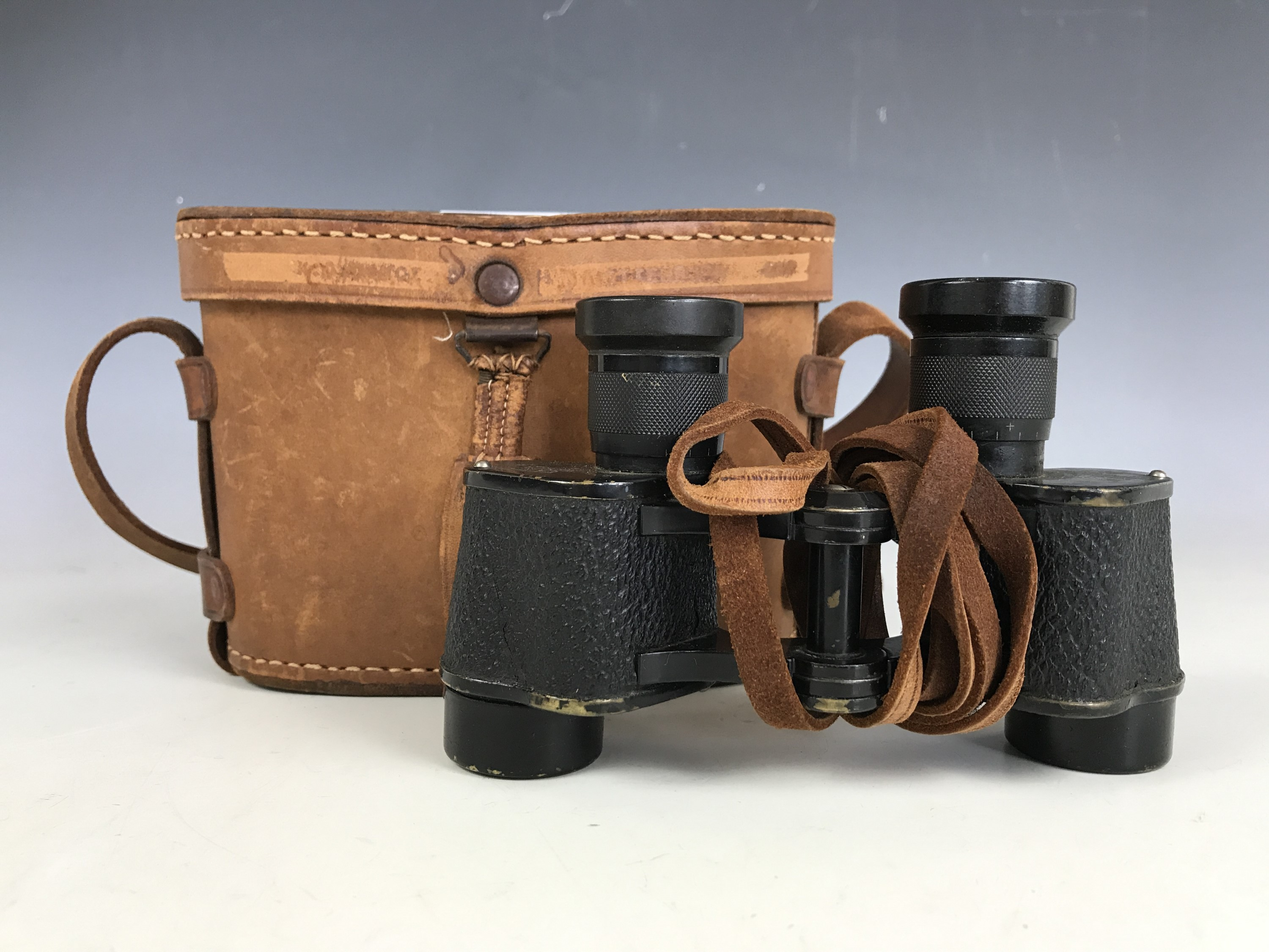 Lot 7 - A pair of 1940's Japanese leather cased Orient 6x20 binoculars