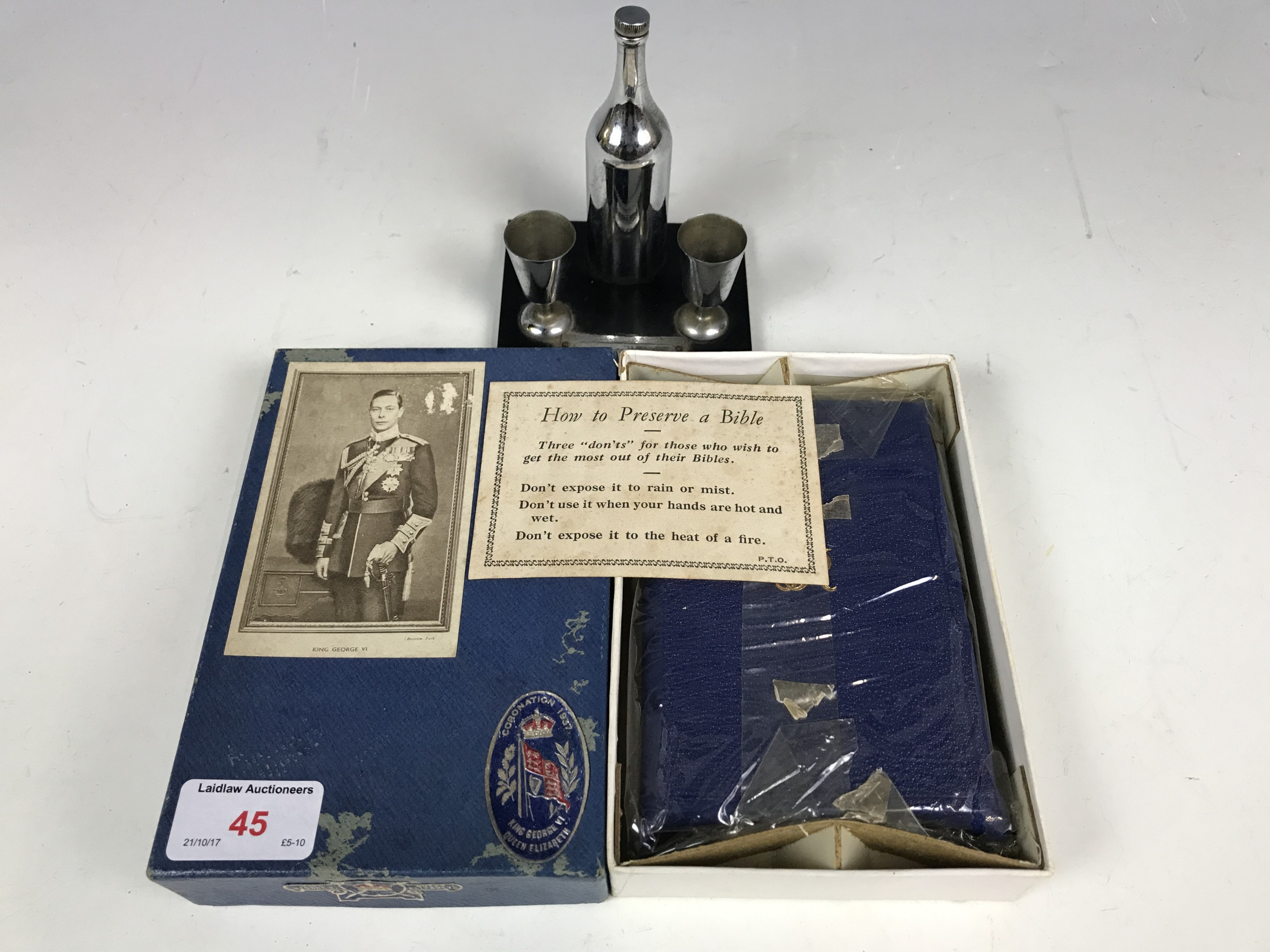Lot 45 - A novelty table cigarette lighter together with a cased George VI 1937 coronation bible