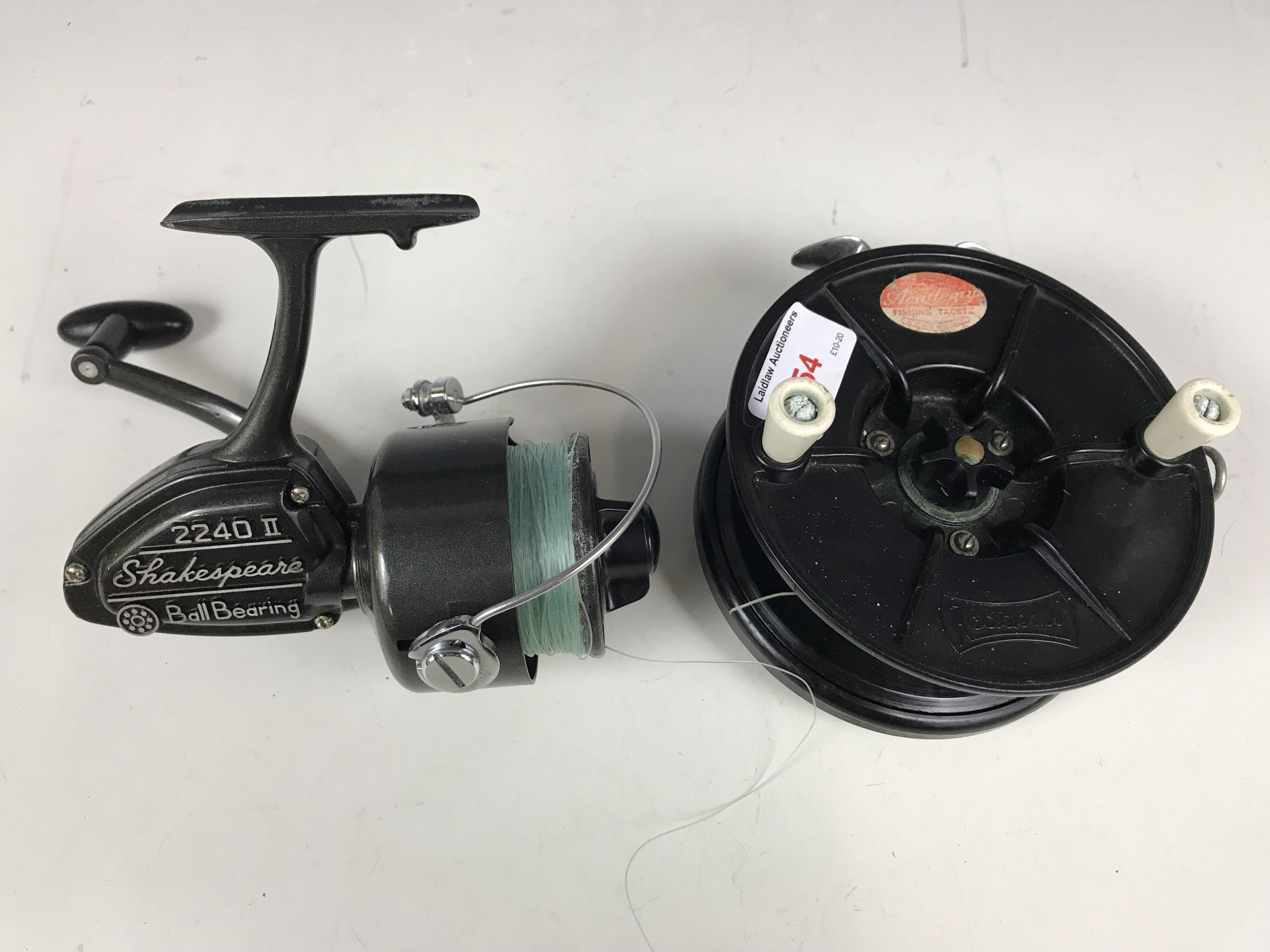 Lot 54 - A vintage Academy centre pin fishing reel together with a Shakespeare 2240 II spinning reel