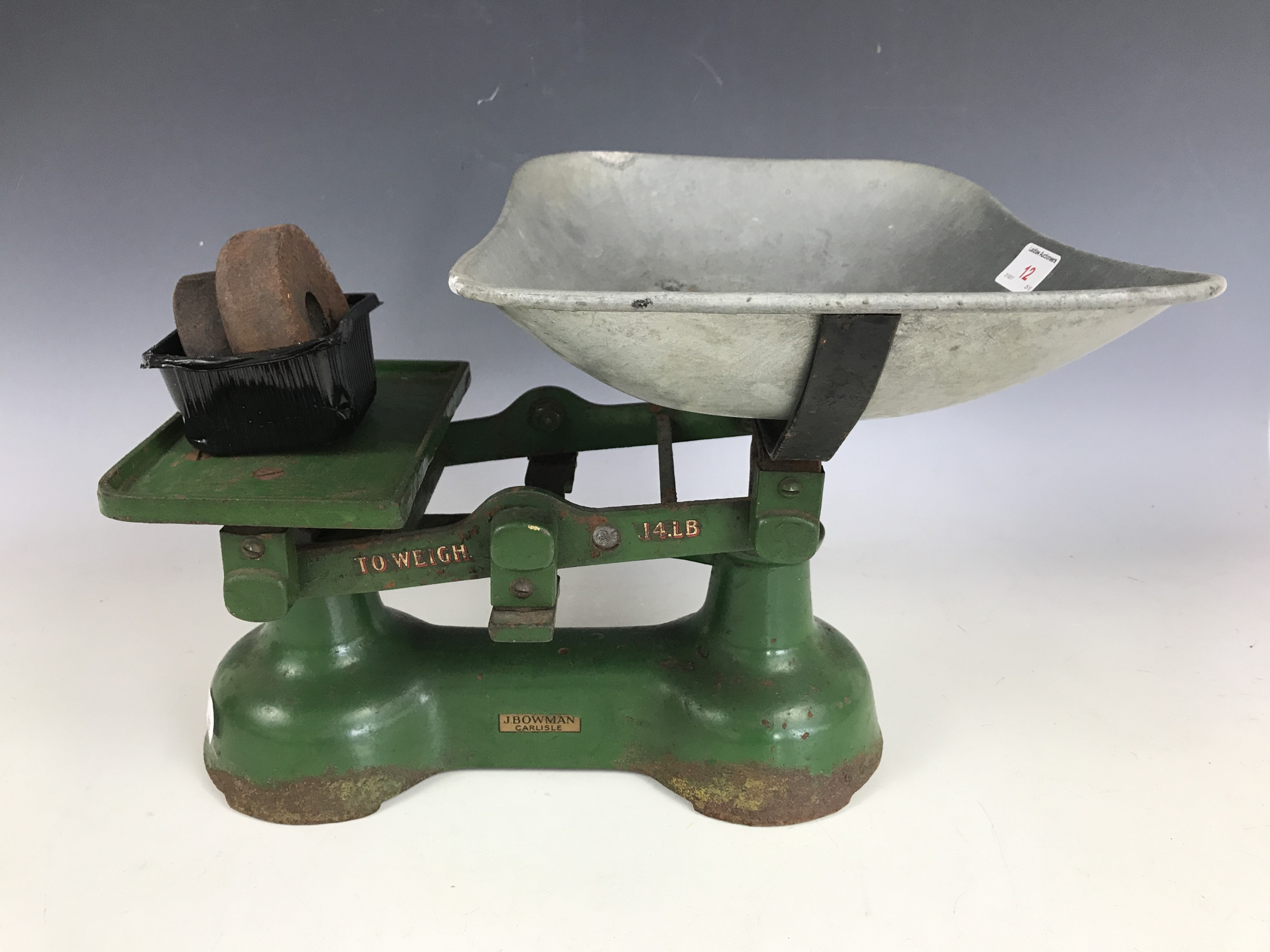 Lot 12 - A vintage set of cast iron kitchen balance scales manufactured by J. Bowman of Carlisle