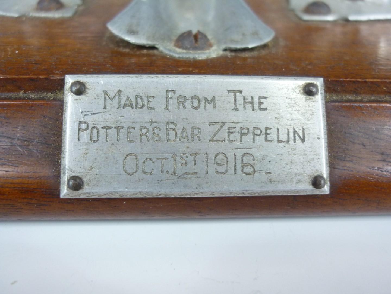 Lot 62 - A First World War Zeppelin wreckage ink standish, comprising four aluminium structural elements