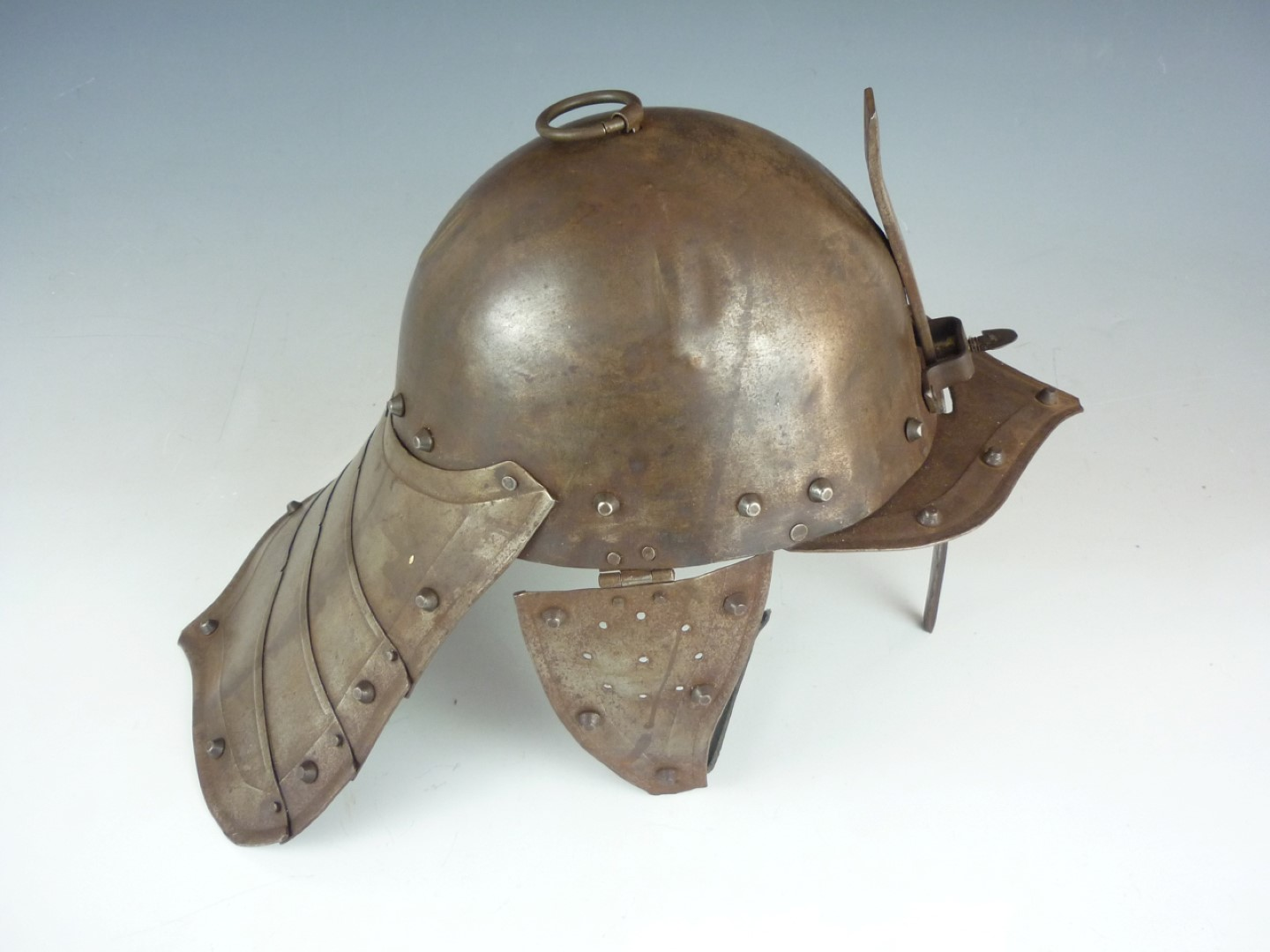 Lot 63 - An old reproduction English Civil War harquebusier's helmet, together with a pikeman's pott