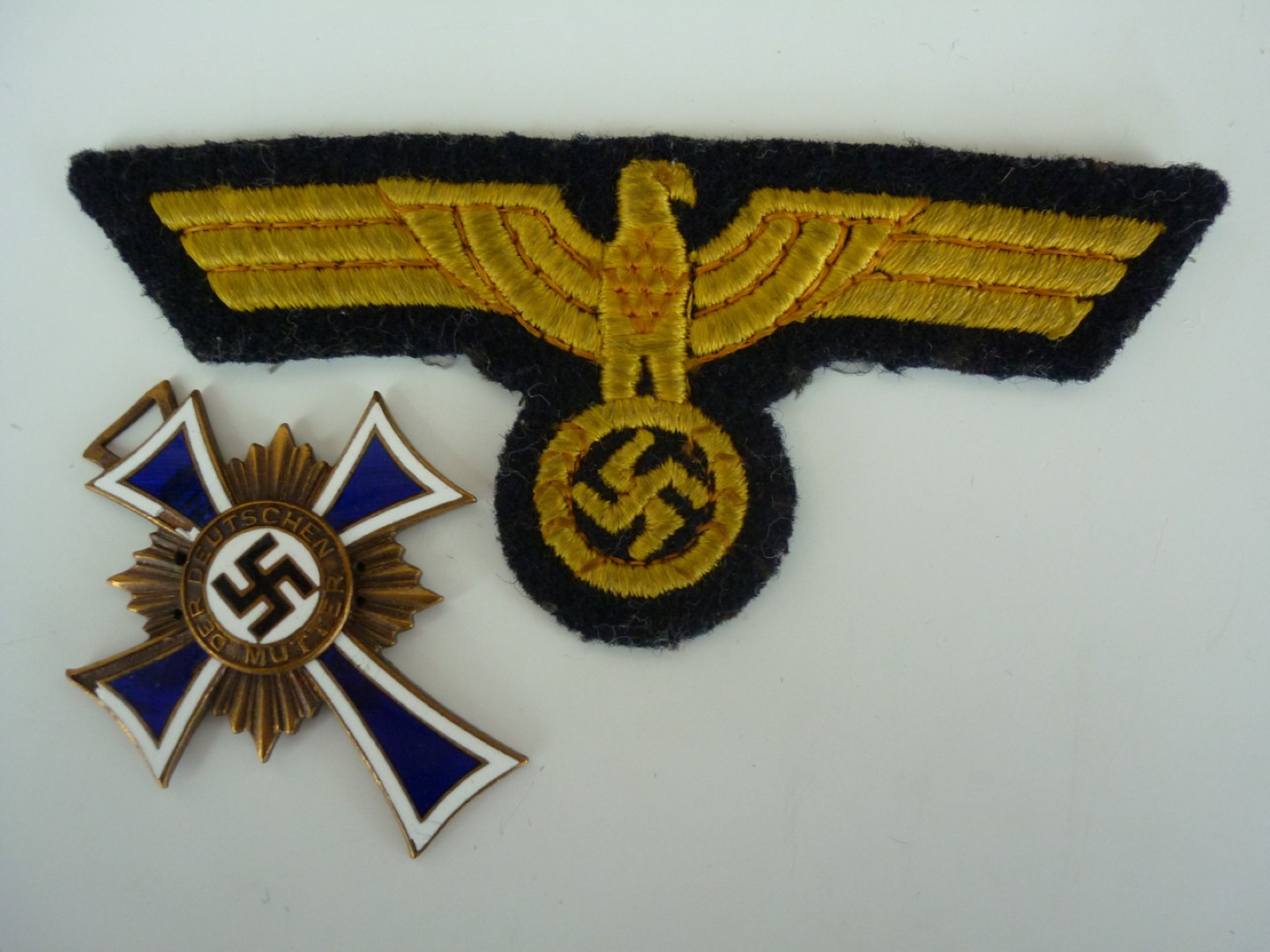 Lot 76 - A Kriegsmarine national emblem and a German Third Reich Mother's Cross in bronze