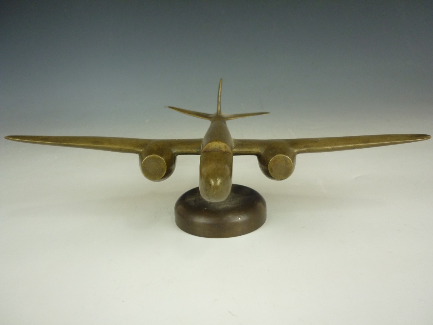 Lot 75 - A Second World War period brass stylized model of a two-engined bomber