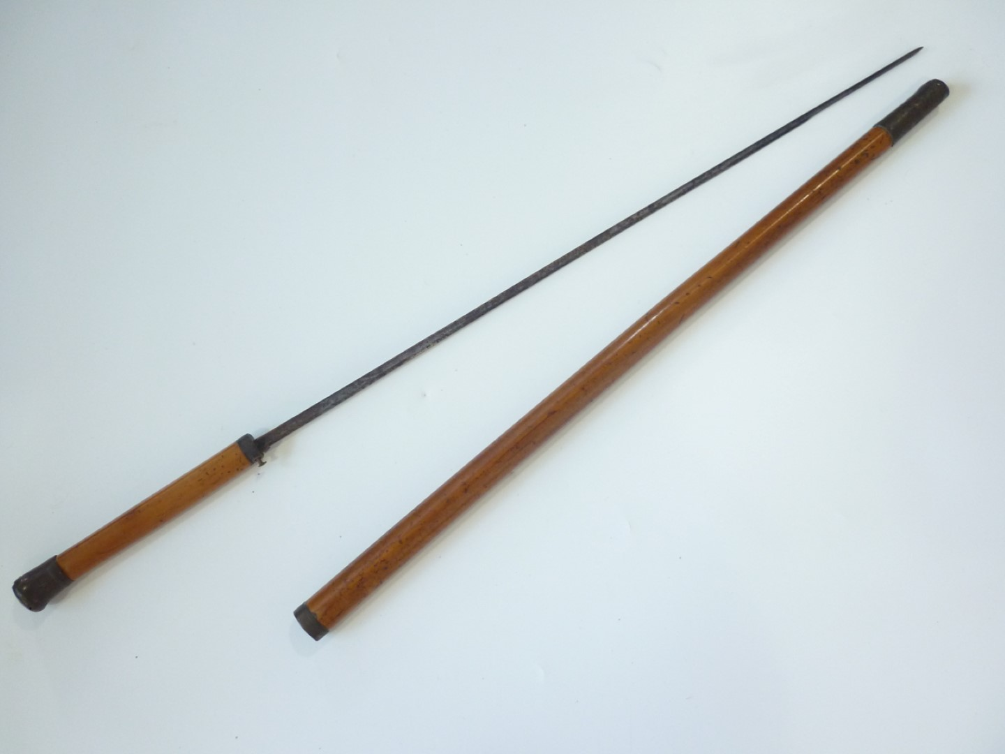 Lot 102 - A 19th Century sword stick, of malacca cane with single-fullered blade, 89 cm, blade 69 cm