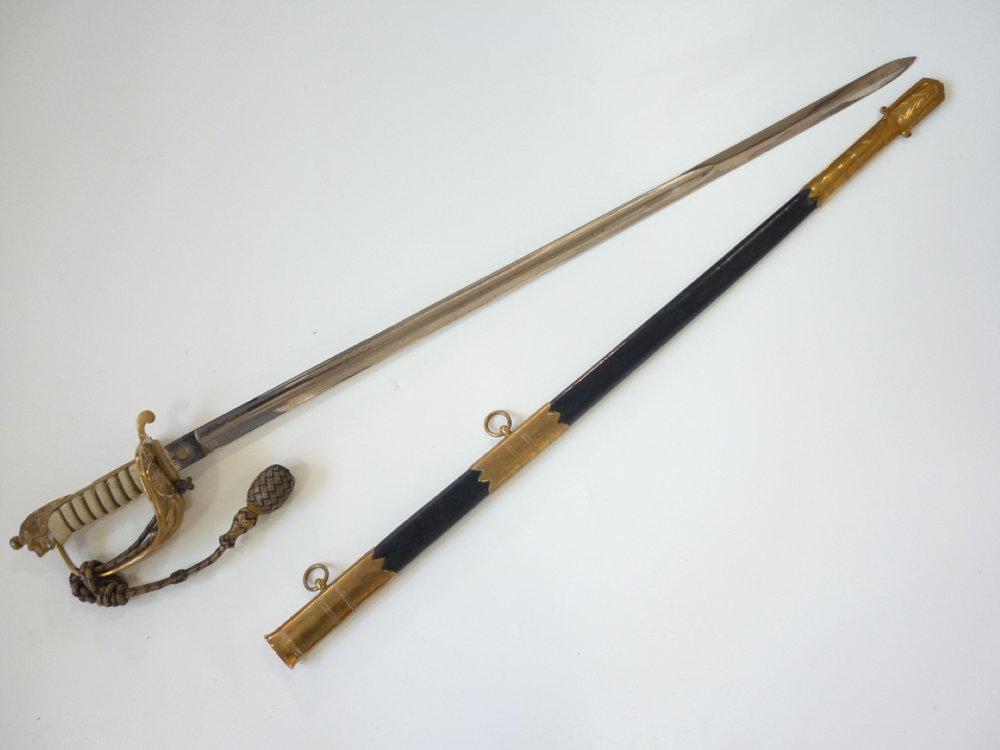 Lot 110 - An early 20th Century Royal Navy Reserve officer's sword, retailed by J R Gaunt, late Edward