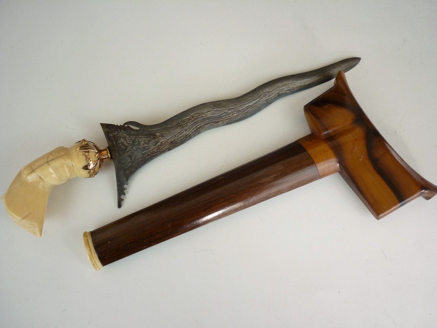 Lot 108 - A Malayan kris with yellow metal mounted carved ivory stylized bird form hilt, wavy blade with