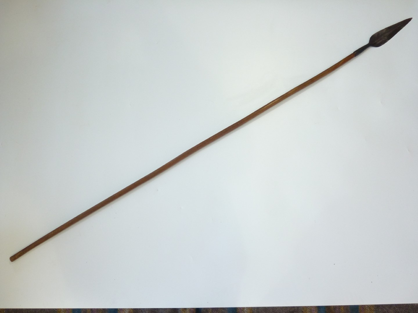 Lot 106 - A 19th Century Zulu iklwa spear together with one other African spear, 144 cm and 159 cm