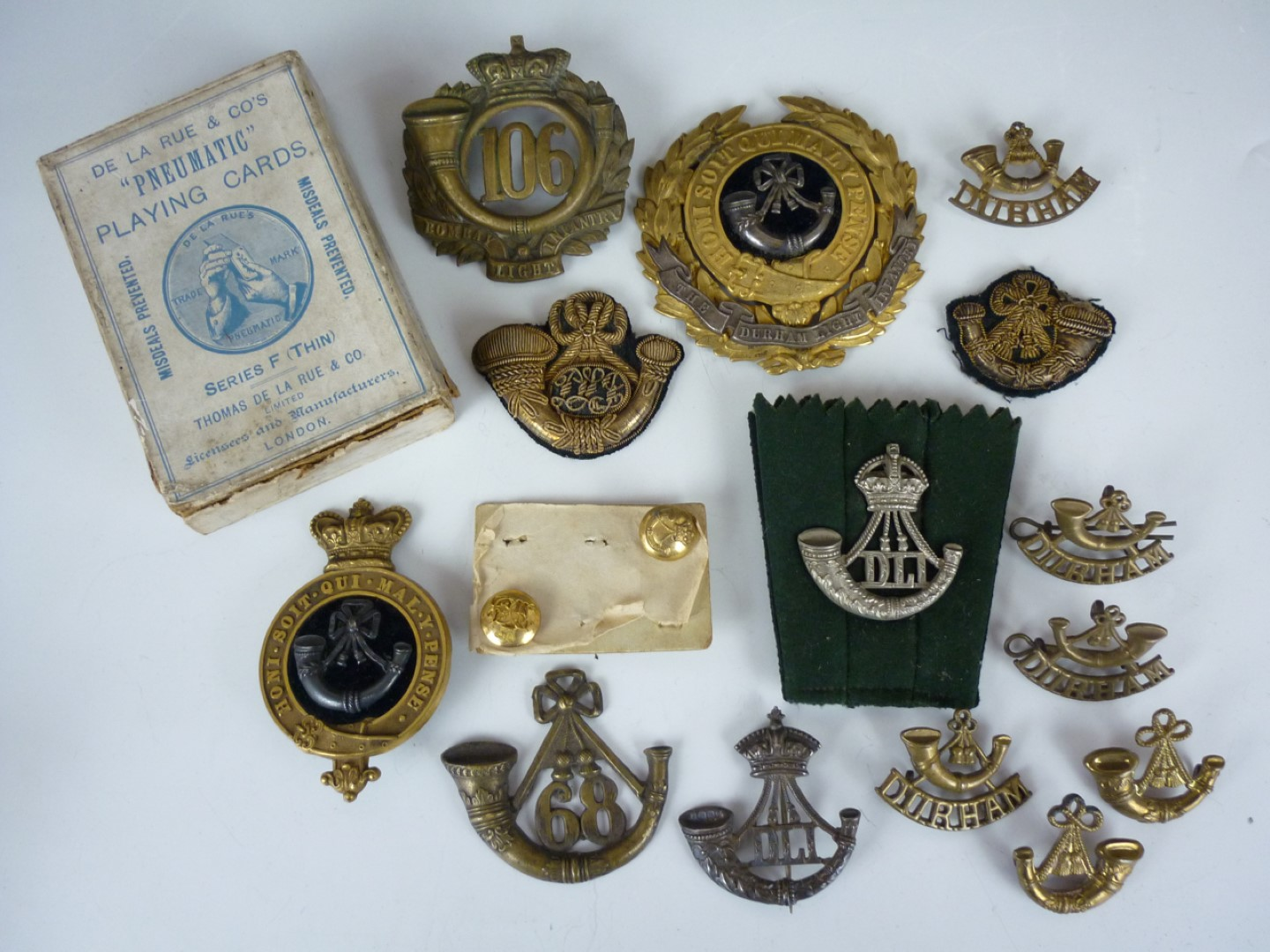 Lot 78 - A group of Durham Light Infantry insignia including officer's and other-rank's glengarry badges,