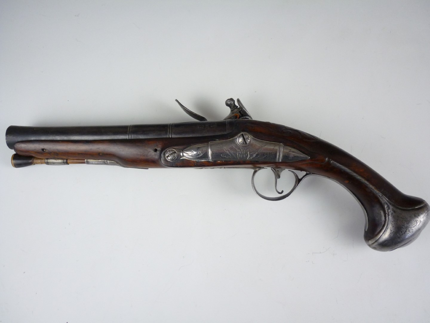 Lot 116 - A mid 18th Century flintlock overcoat or holster pistol by Thomas Richards, having a stepped swamped