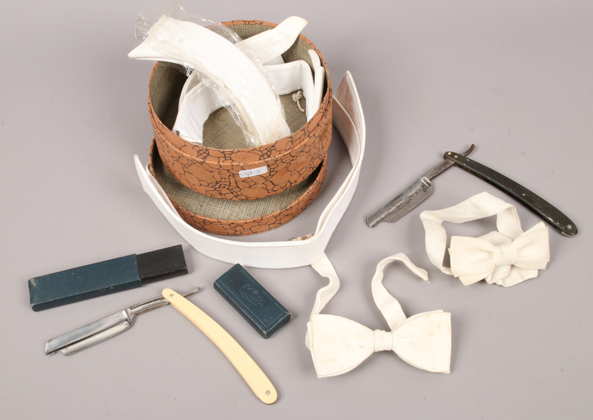 Lot 56 - A small collection of gentleman's collars, bow ties and two cut throat razors (damaged) by Joseph
