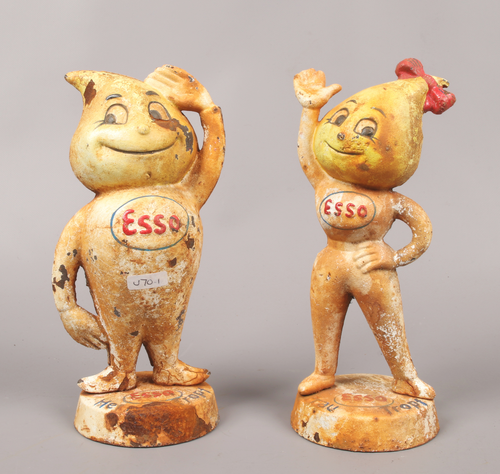 Lot 15 - Two ESSO advertising cast iron money boxes marked Herr Tropf and Frau Tropf, standing 23.5cm tall.