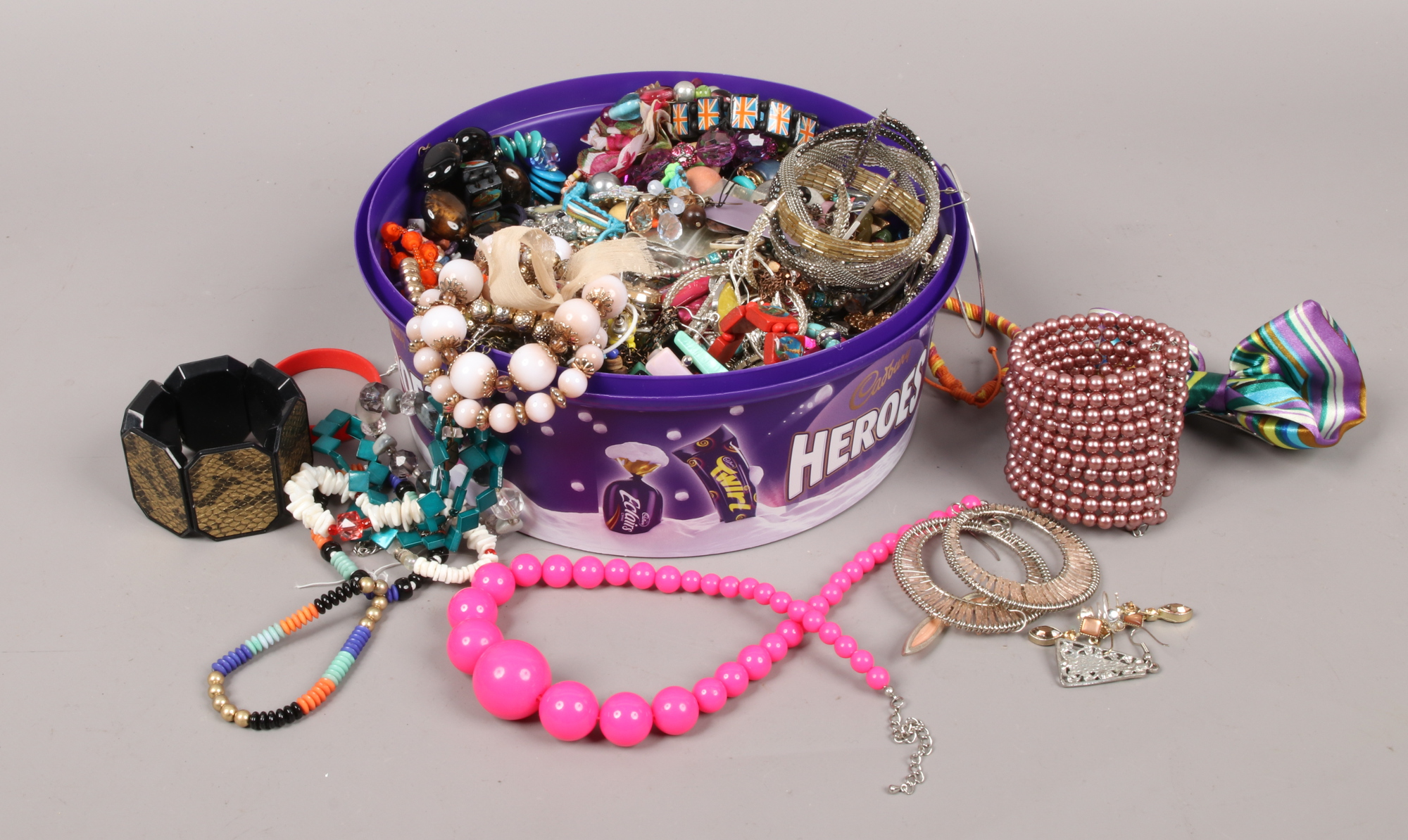 Lot 49 - A box of costume jewellery to include beads, bangles, earrings etc.