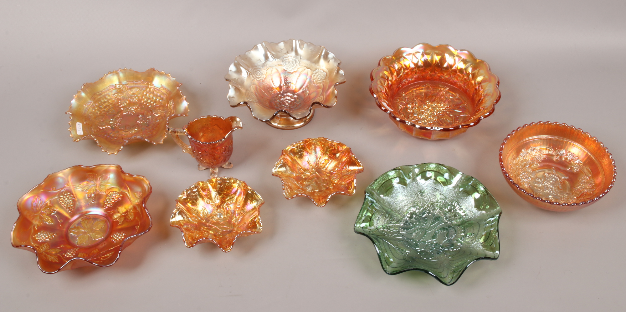 Lot 2 - A collection of mainly orange carnival glass, to include one green glass example.