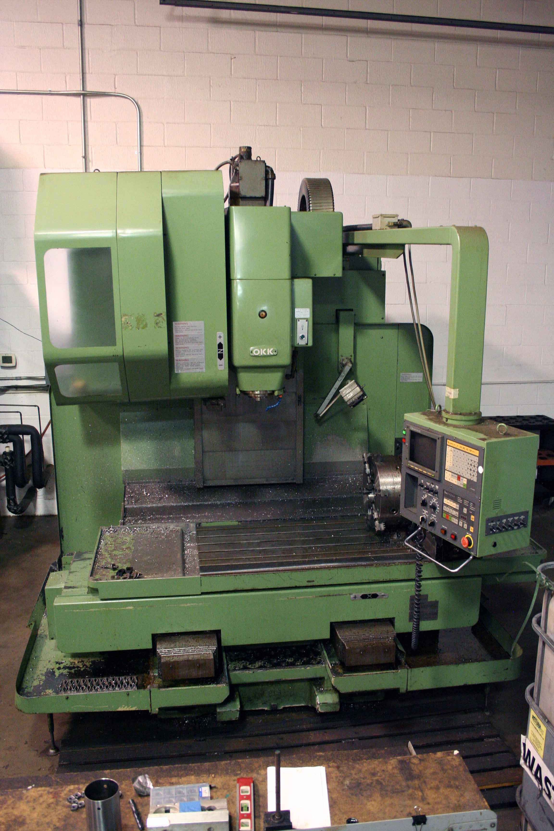 "Lot 2 - CNC VERTICAL MACHINING CENTER, OKK MDL. MCV550, (est.) new 1993, 41"" x 21"" table, 30 pos. ATC, CAT-"