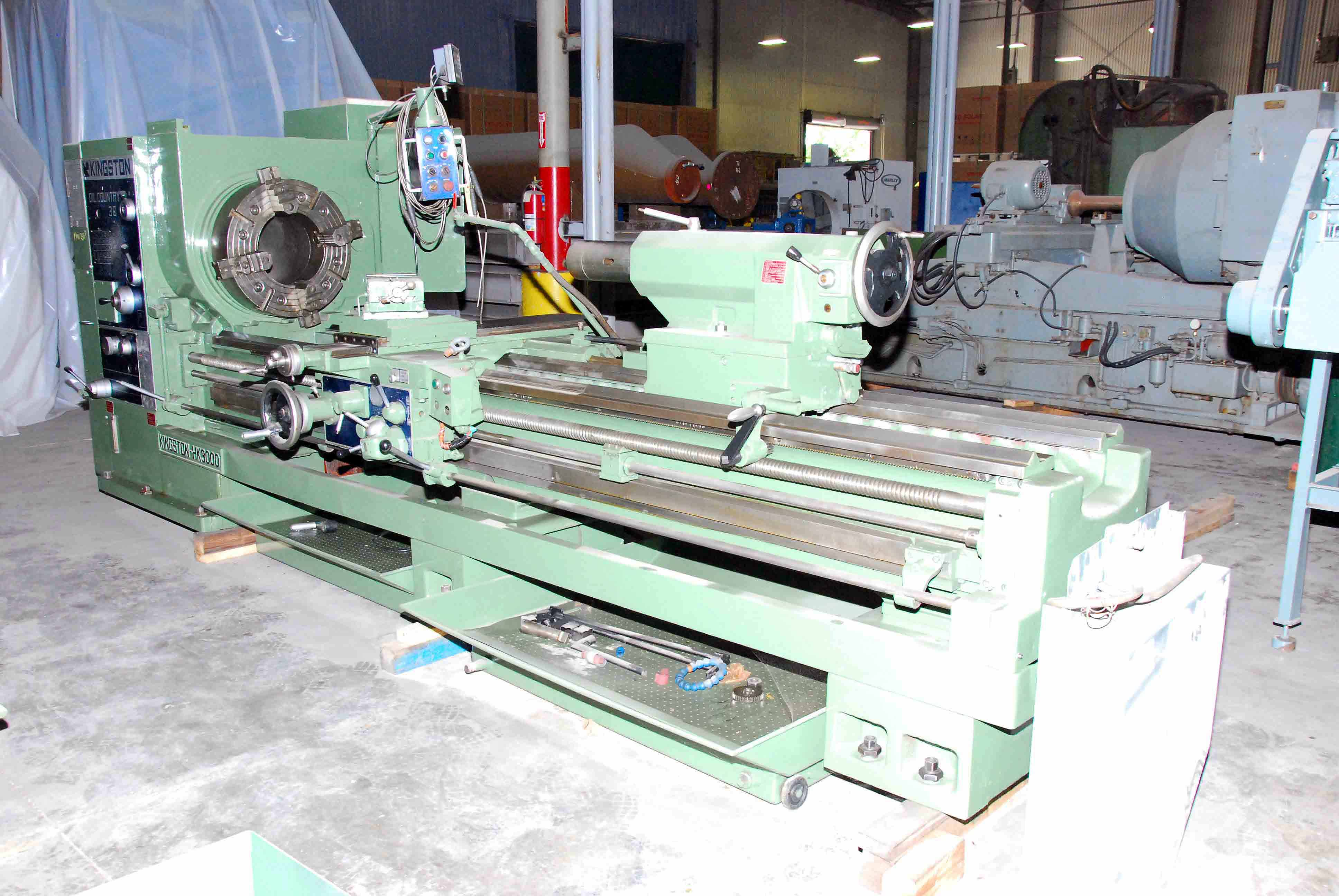 "Lot 18 - HOLLOW SPINDLE LATHE, KINGSTON 30"" OIL COUNTRY MDL. HK-3000, new 2007, 12/5"" spdl. bore, 30"" sw."
