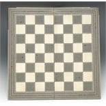 A 19th century Anglo-Indian Sadeli marquetry folding chessboard,