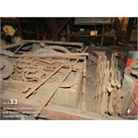 Contents under table wrought iron fixture, assorted steel parts