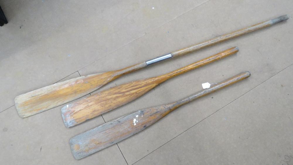 Lot 527 - Three vintage wooden oars.