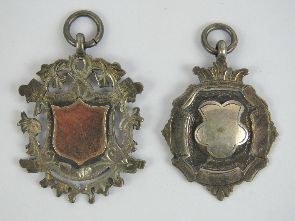 Two silver fobs, both unengraved, one wi