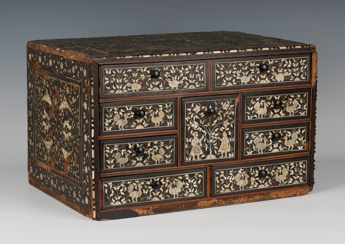A late 17th/early 18th Century Indo-Portuguese hardwood, ivory and green stained ivory inlaid table-top chest