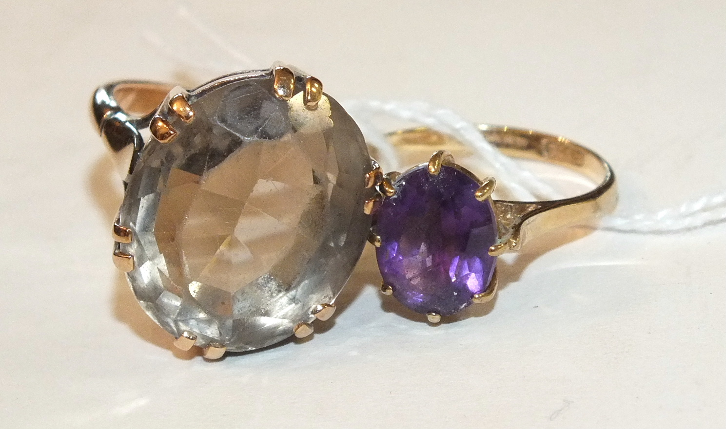 Lot 217 - An amethyst ring in 9ct gold mount, size L, 2g and a large 9ct gold ring set smokey quartz, size