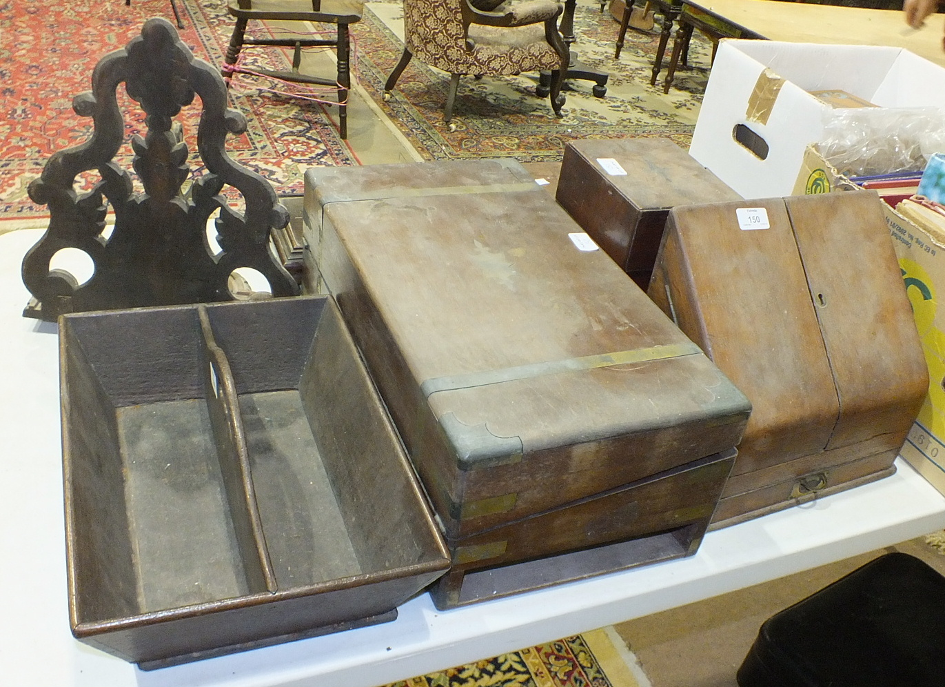 Lot 150 - An Edwardian oak stationery box, the sloping doors revealing a fitted interior, 31cm wide, a