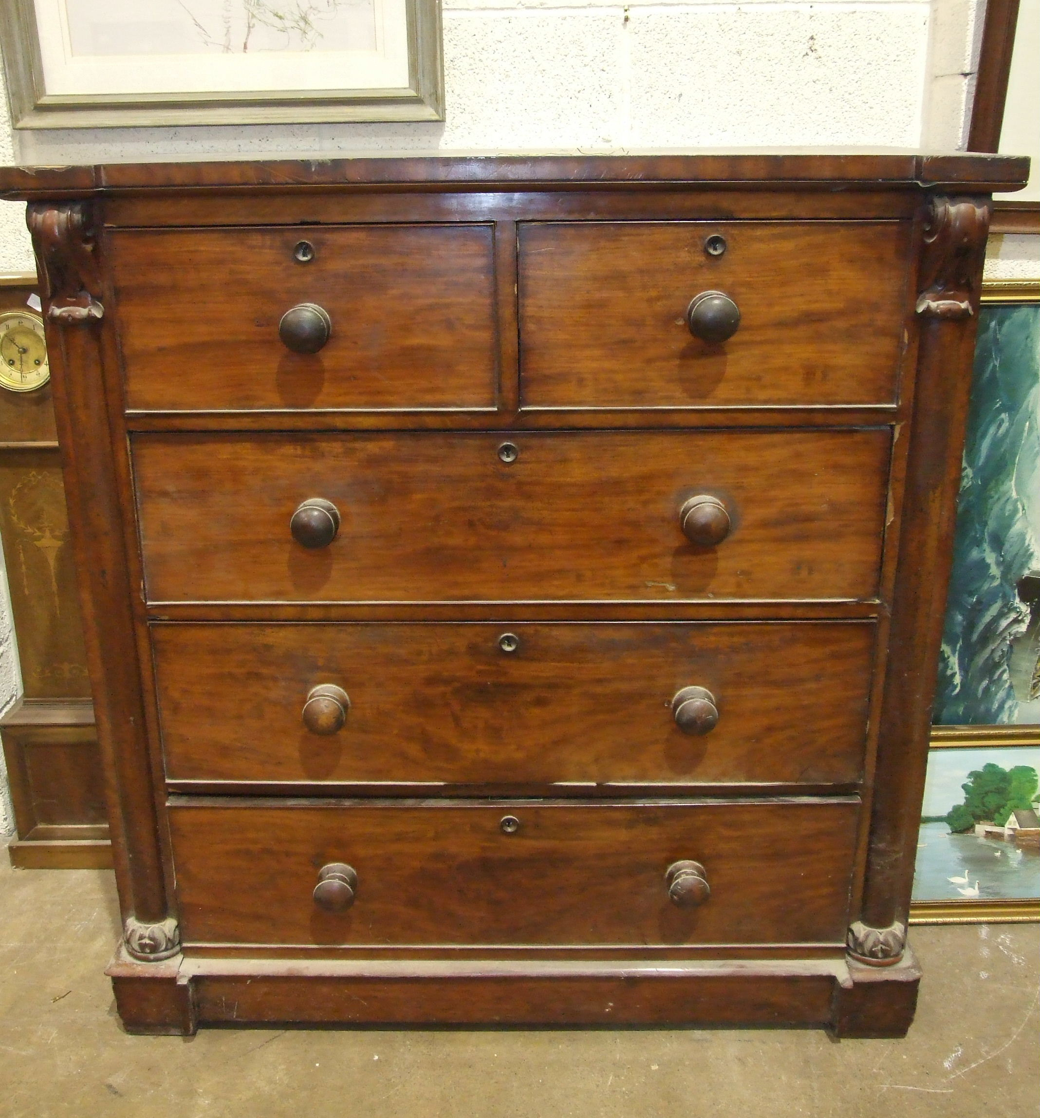 Lot 5 - A 19th century mahogany straight-front chest of two short and three long cock-beaded drawers