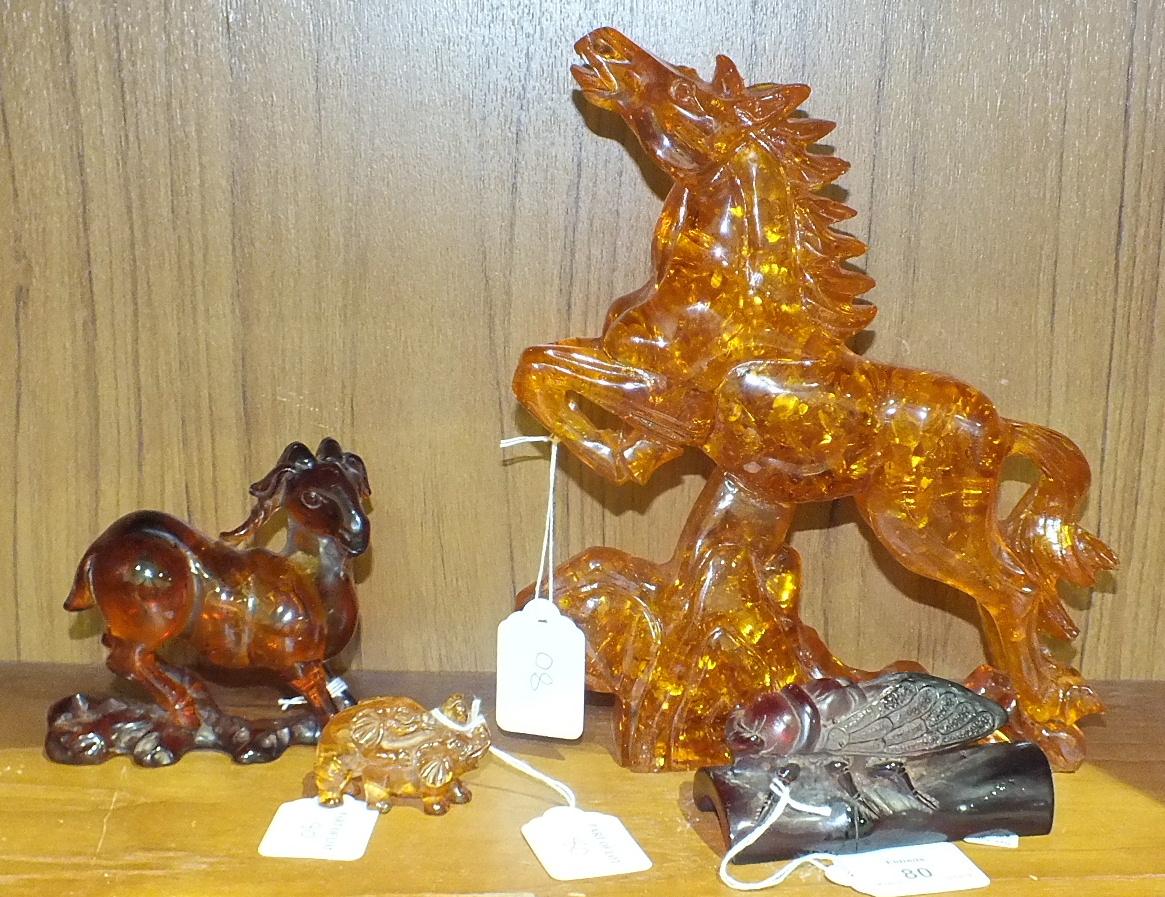 Lot 80 - Four faux amber animal carvings, (4).