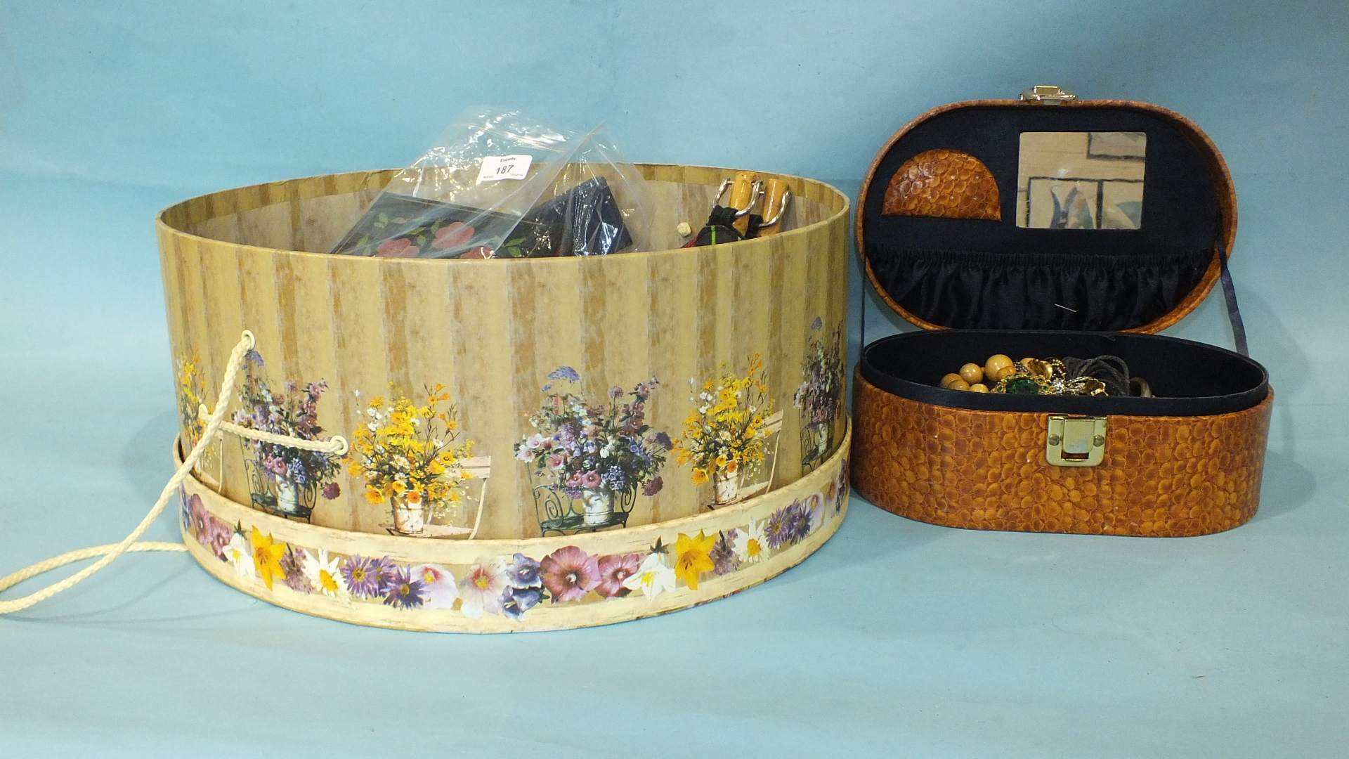 Lot 187 - A silver RAF sweetheart brooch and a large quantity of costume jewellery, etc, in a hat box.