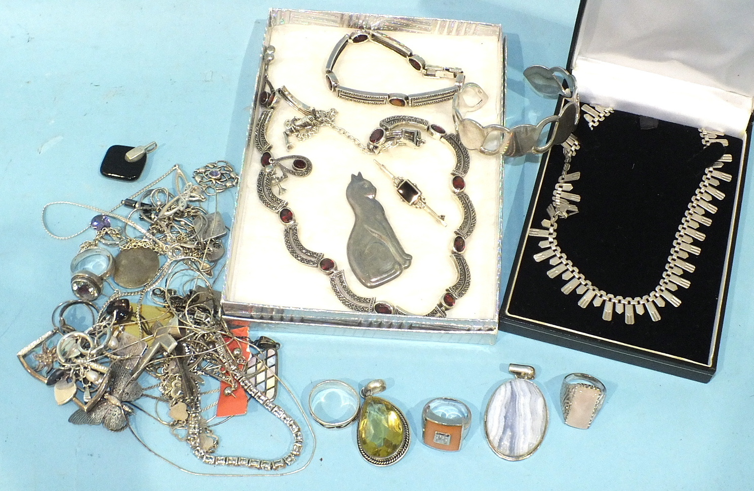 Lot 211 - A silver necklace, bracelet and earrings set marcasite and garnets, a silver fringe necklace and