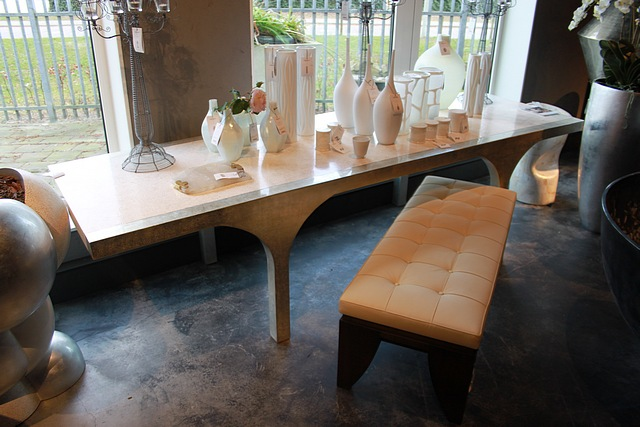Lot 159 - Arc large dining table the eggshell is inlaid into one of nature's most durable products: lacquer.