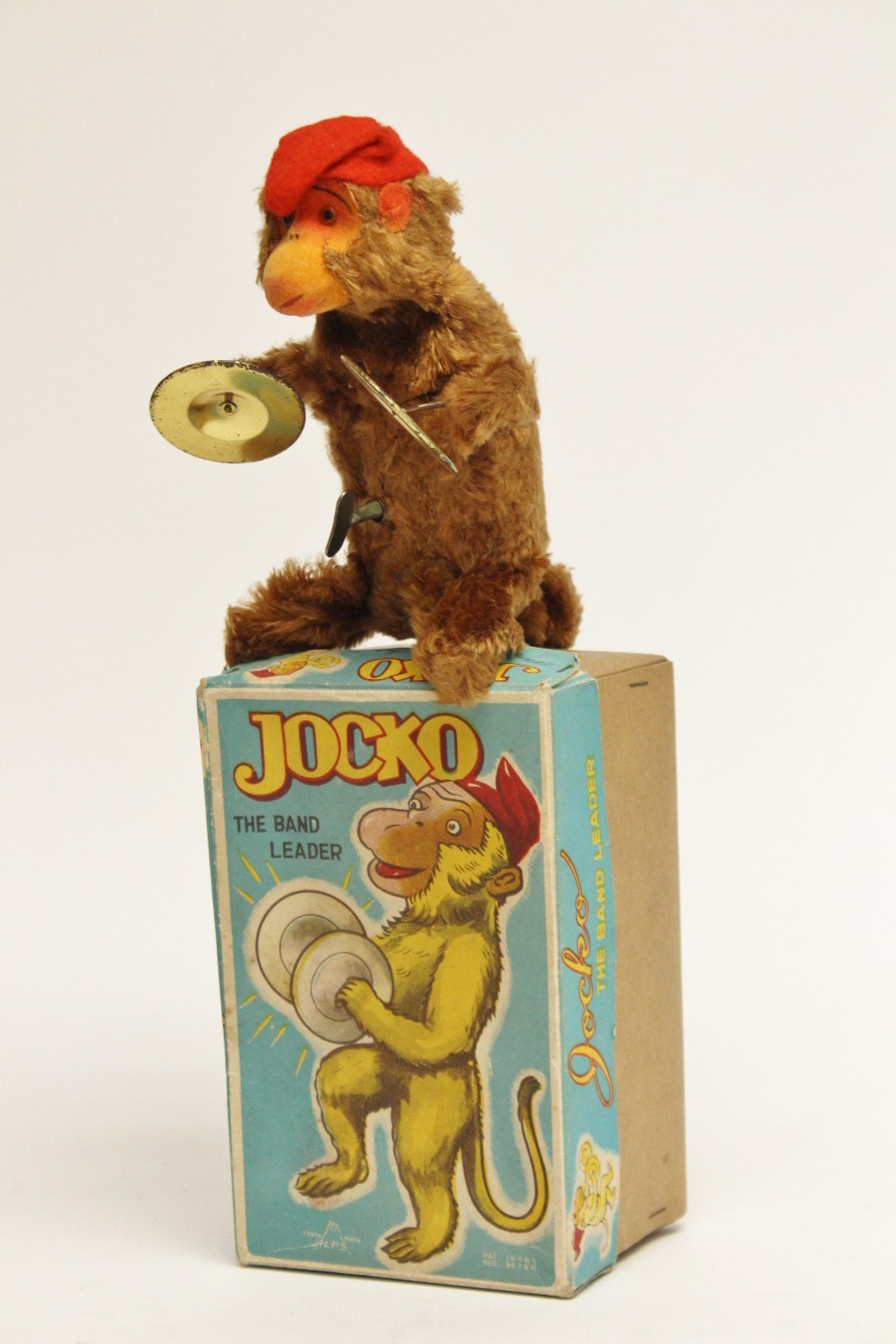 Tinplate A Boxed Tin Plate Monkey With Symbols Jocko The Band Leader