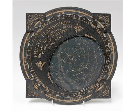 A Philips Planisphere 'Showing the Principal Stars visible for every hour in the Year' with explanation card to the back, dia