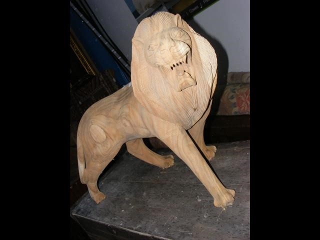A carved wooden Lion ornament - 65cm high