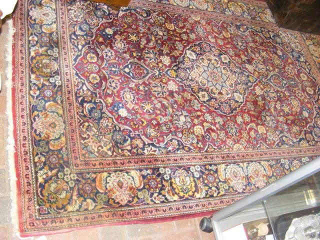 An old Middle Eastern rug with geometric floral bo