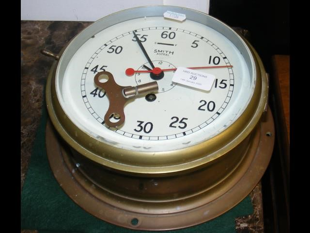 A Smith circular bulkhead clock - 22cm diameter